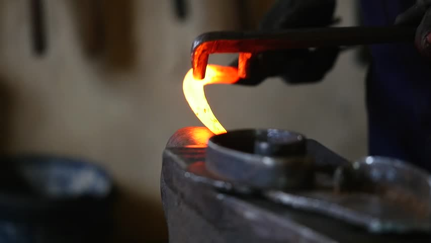 Blacksmith working with hot glowing metal, bending steel in a smithery, slow motion. | Shutterstock HD Video #30059242