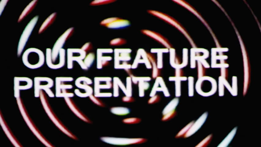 Vhs real projection: the text Our feature presentation appears over a set of spinning circles with a lens flare at the beginning. Grindhouse low-budget b-movie style.