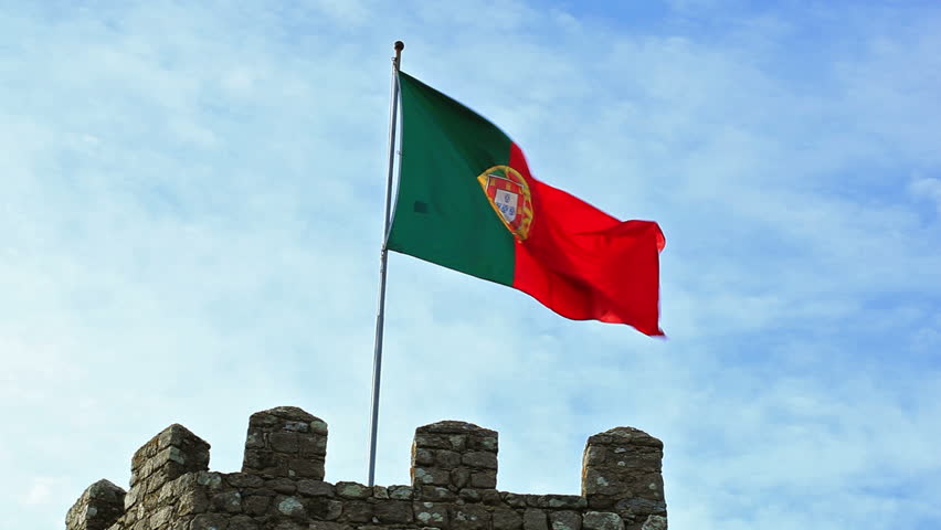 Portugal flag in fortress tower against blue sky  #3011908