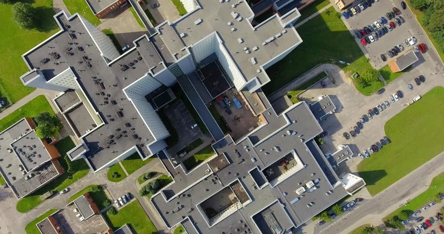 Establishing shot, big modern imposing building, may represent company headquarters, bank, hospital, state foundation, etc. aerial view.