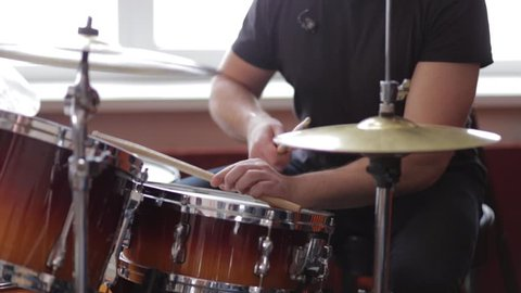 The musician plays the drums