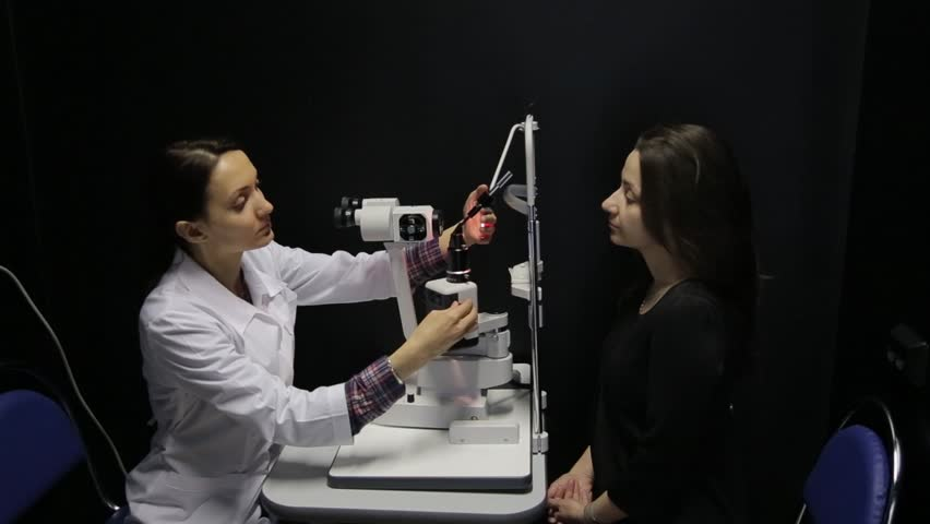 The doctor conducts a study of the patient's eyes using the newest technology | Shutterstock HD Video #30131926