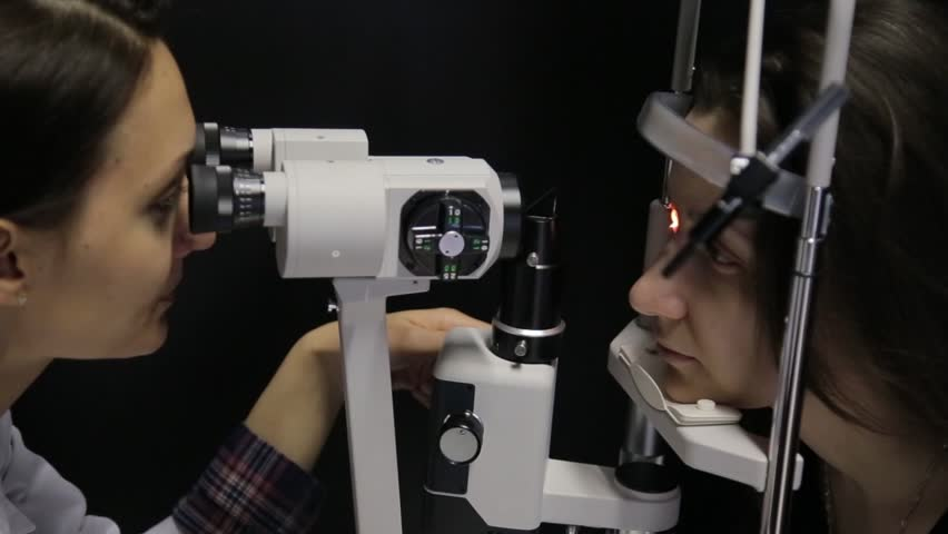 Close-up. The doctor performs a patient's vision study using the newest technology | Shutterstock HD Video #30131998