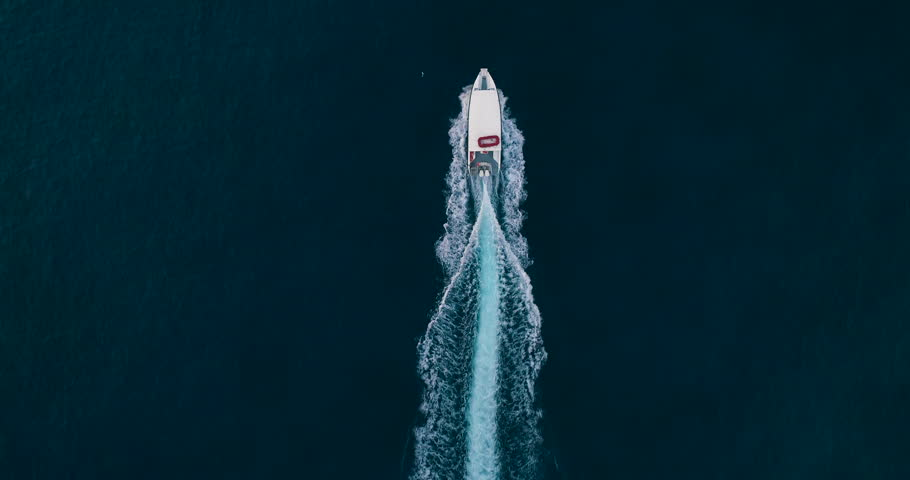 Slow Motion Aerial Drone Shot Over Speed Boat Passing Through Beautiful Blue Ocean Tropical Destination Jamaica Traveling To New Destinations Summer Vacation Concept 4k