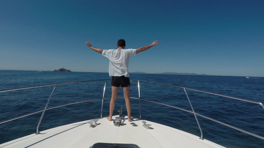 Man Facing The Wind At The Bow Of Motorboat | Shutterstock HD Video #30138592