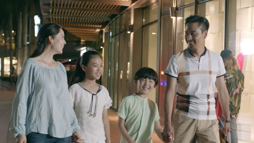 Asian family of 4 walking & shopping outside a shopping mall at night in slow motion   Shutterstock HD Video #30151735