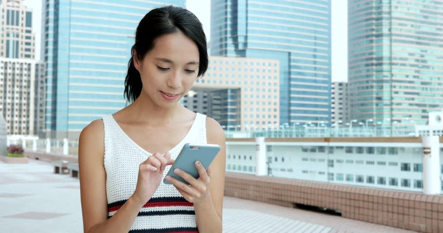 Woman using mobile phone in Hong Kong  #30173272