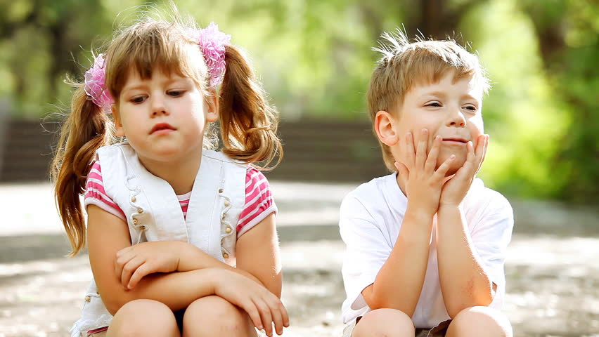 Two child funning in park, outdoors | Shutterstock HD Video #3017371