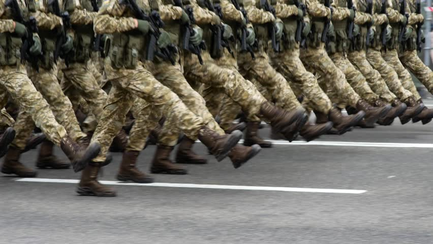 Military parade in the city. March of soldiers