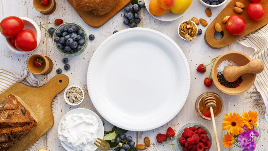 Making sandwiches with homemade bread, ricotta cheese, honey and various fresh fruits: blueberry, raspberry, apricot.  Proposing healthy eating. Stop motion animation, top view | Shutterstock HD Video #30200269