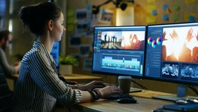 Female Videographer Edits and Cuts Footage and Sound on Her Personal Computer. Her Office is Modern and Creative Loft Studio. Shot on RED EPIC-W 8K Helium Cinema Camera.