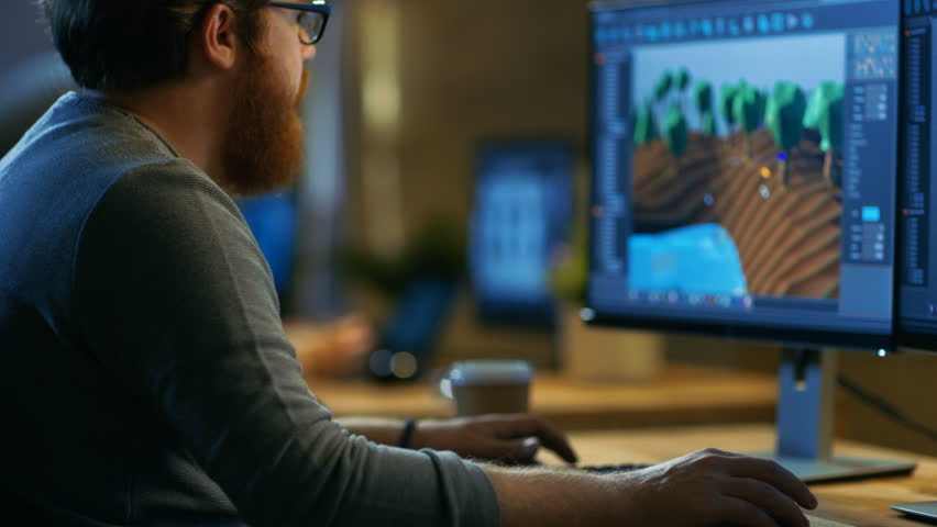 Male Game Developer Works on a New Level Design. He's Handsome Bearded Man with Glasses and Works in a Creative Office with other Talented People. Shot on RED EPIC-W 8K Helium Cinema Camera. | Shutterstock HD Video #30236158