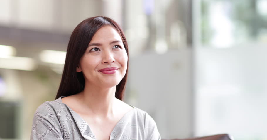 Businesswoman looking confidently at camera   Shutterstock HD Video #30243664