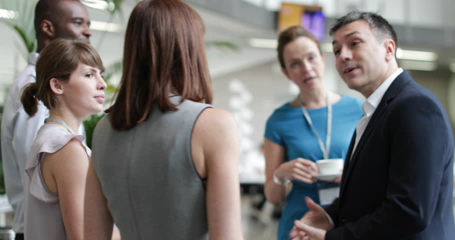Business executives shaking hands at a networking event