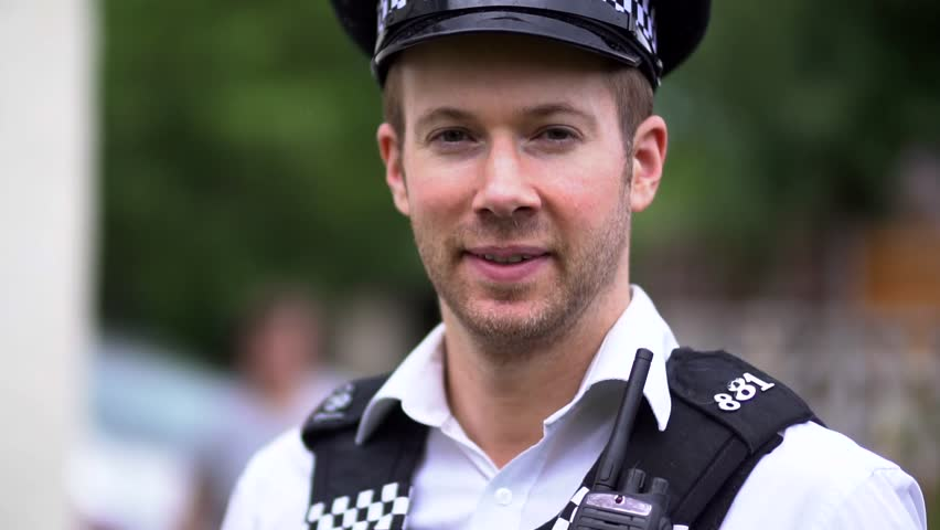 Portrait Of A Police Officer, Happy and Friendly, Close Up in Slow Motion. Wearing Black and White Uniform Including Hat. White Caucasian in 30's. | Shutterstock HD Video #30254173