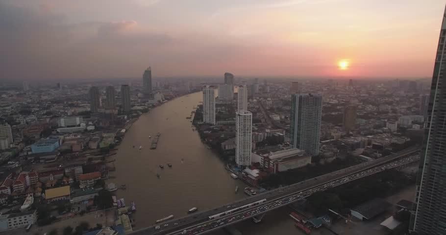 Sathorn And Chao Phraya River At Sunset, Bangkok, Thailand, Aerial Pan Shot #30255715