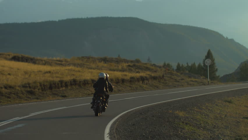 Couple of Motorcyclists on a Motorcycle are Driving along a Beautiful Country Road | Shutterstock HD Video #30262798