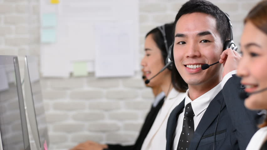 Happy smiling Asian telemarketing customer service agent team, call center job concept