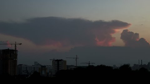 Townscape with Cumulonimbus clouds on sunset, time-lapse 4K.