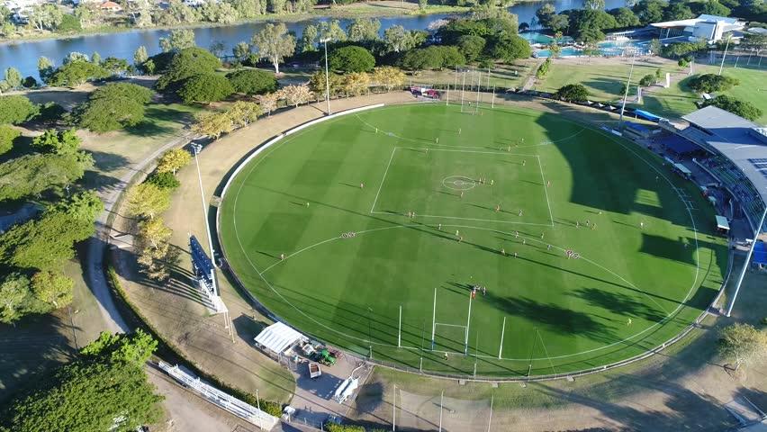 4K Aerial Footage AFL football oval sports field - Townsville Australia - wide side pan