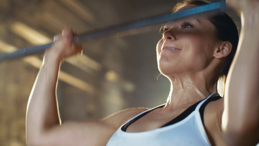 Beautiful Athletic Woman Wipes Sweat from Her Forehead with a Hand. She's Tired after Intensive Fitness Exercise. Shot on RED EPIC-W 8K Helium Cinema Camera.