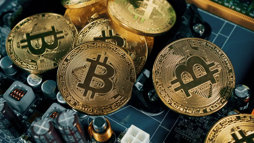 Crypto currency Gold Bitcoin - BTC - Bit Coin. Bitcoins on the motherboard.