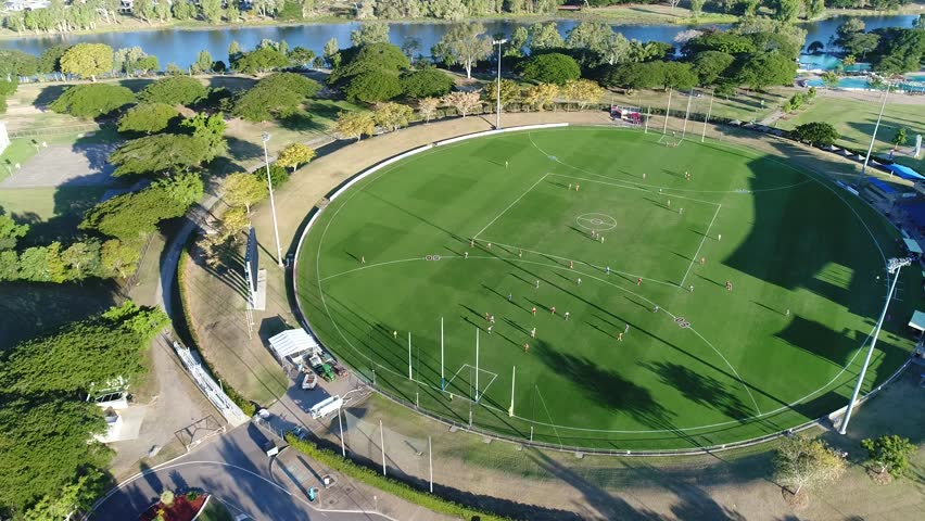 4K Aerial Footage AFL football oval sports field - Townsville Australia - side pan
