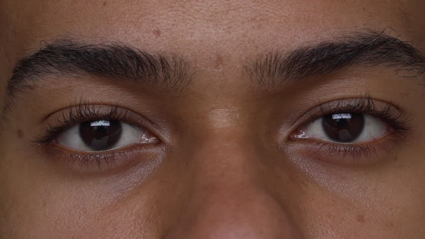 extreme close up beautiful eyes of tan man expressing anger slow motion. Facial expressions, concept of emotions #30334417