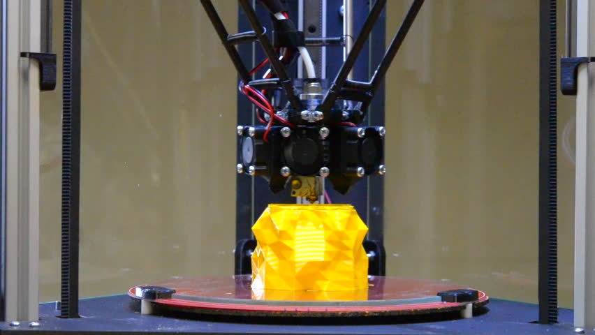 3d printing printer bright yellow model close-up. Automatic 3D printer performs plastic modeling in laboratory. Modern additive technologies, 4.0 industrial revolution. Timelapse Royalty-Free Stock Footage #30337168