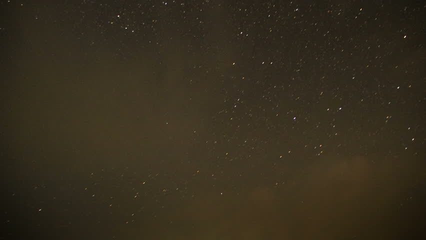 Clouds moving in the night sky against a background of stars. Black clouds pass fly sky time lapse background. #30344347