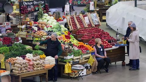 MOSCOW - JAN 18, 2017: Traders work in stores with fruits and vegetables at Danilovsky marketplace