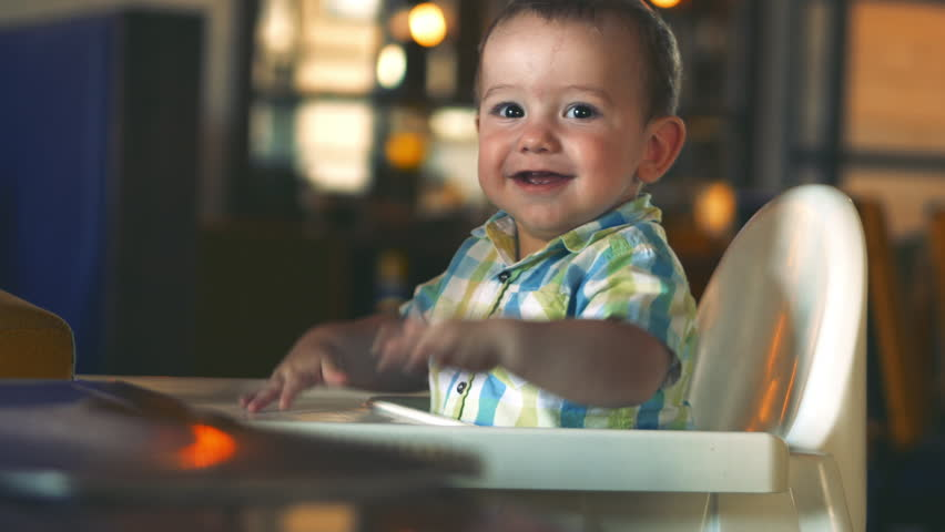 Charming Child Laughs and Claps his Hands. Cute Little Baby Eating Her Dinner.  4k.
