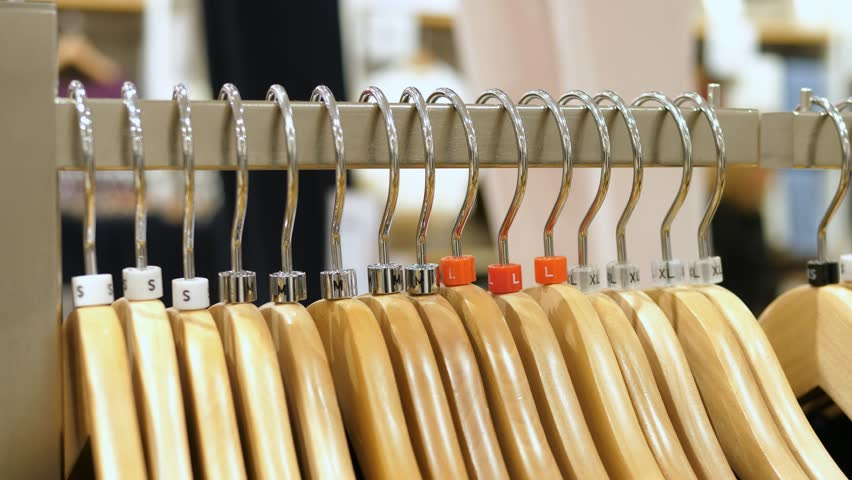 Clothes on Hangers In Clothing Shop. Shopping Concept. 4K Closeup.  | Shutterstock HD Video #30360586