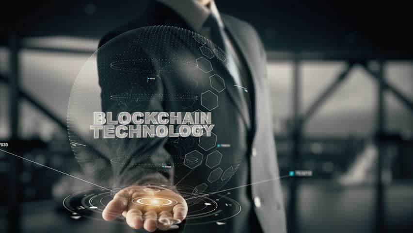Blockchain Technology with hologram businessman concept Royalty-Free Stock Footage #30373537