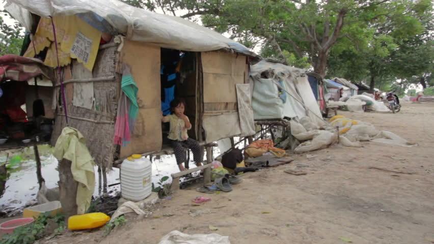 Child in house in slum area of Cambodia