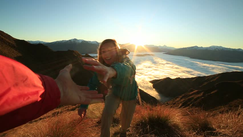 Teammate helping hiker to reach summit . Couple hiking in New Zealand, hand reach out to help female hiker reach the summit. A helping hand concept  | Shutterstock HD Video #30393361