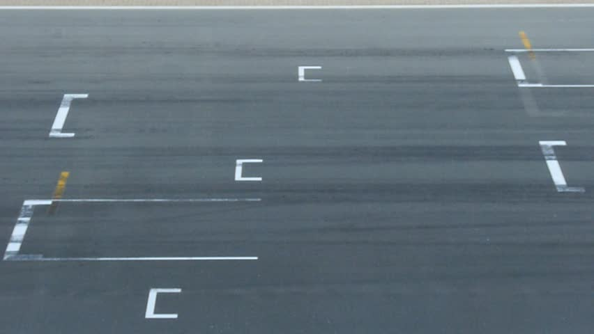 Fast racing cars passing on starting grid. | Shutterstock HD Video #3040597