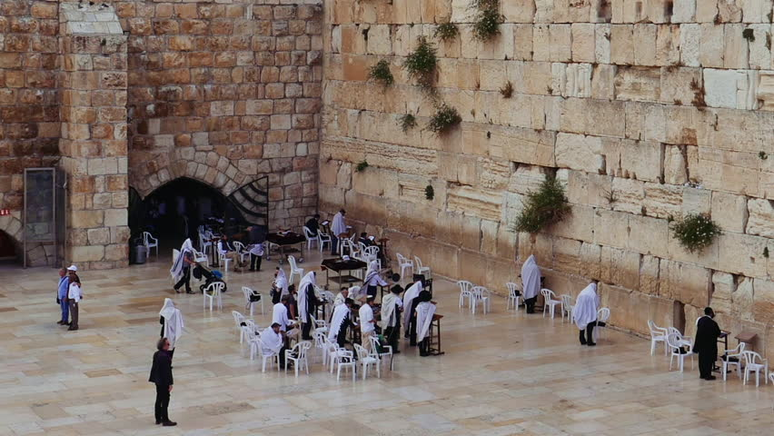 Western Wall or Wailing Wall or Kotel in Jerusalem. People come to pray to the Jerusalem western wall. The Wall is the most sacred place for all jews in the world. | Shutterstock HD Video #30432280