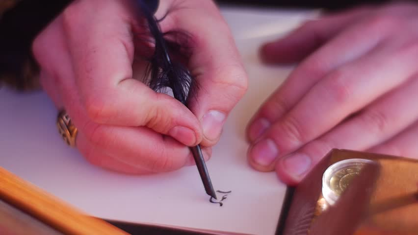 Teacher of Calligraphy Demonstrates a Process of Writing of Beautiful Letters With Black Ink and an Bird's Feather. a Beautiful Golden Ring With Carved Patterns is on a Man's Finger. Black Letters,
