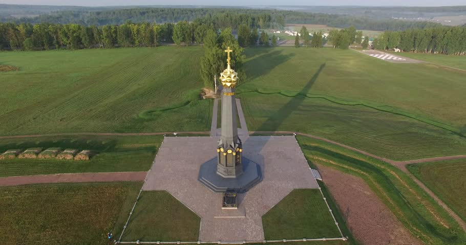4K aerial video footage of old beautiful 1812 war historical military memorial erected in 1912, road and fields area around it near Borodino 120 km west of Moscow, capital of Russia on summer morning