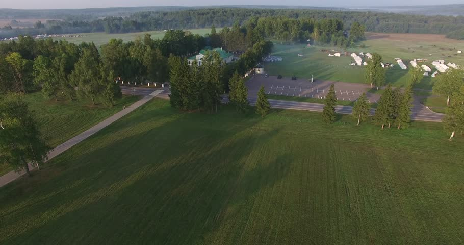 4K aerial video footage of old 1812 war historical military fields, road and tented camp, area around it near Borodino 120 km west of Moscow, capital of Russia on summer morning