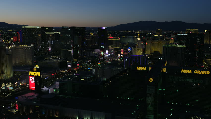Las Vegas - May 2017: Aerial illuminated sunset dusk view of Las Vegas Strip Resort Hotels and Casinos city suburbs Nevada USA RED WEAPON
