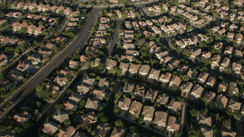 Aerial view of suburban city property development residential commuter homes on the outskirts of Las Vegas Nevada USA RED WEAPON