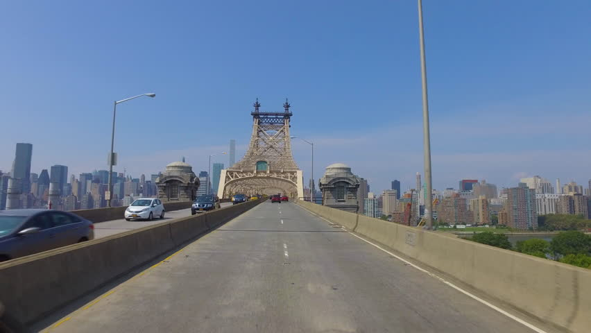 day POV driving onto Queensboro Bridge towards Manhattan