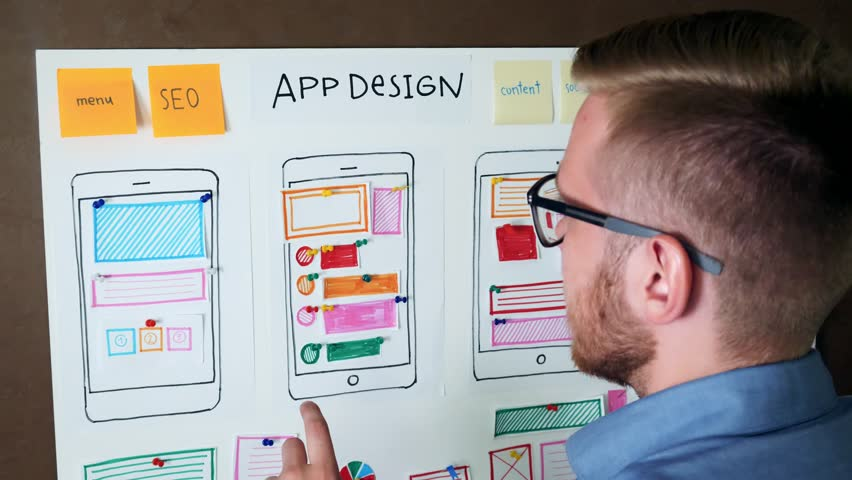 Young UX designer developing Mobile app responsive layout Royalty-Free Stock Footage #30464182