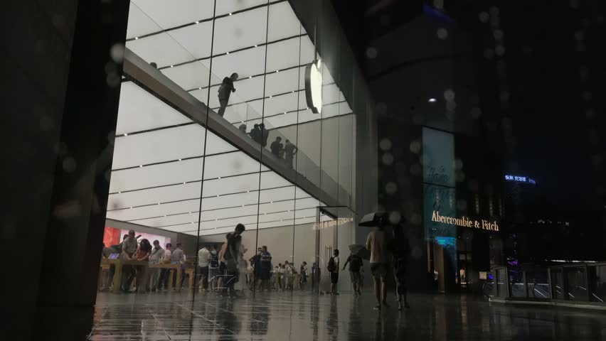 GUANGZHOU, CHINA - September 03. The Apple Store in raining background on September 03, 2017 in Guangzhou. This is first Apple Store in Guangzhou,Opening in January 28, 2016.