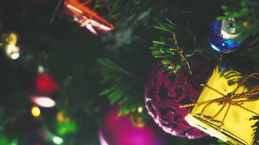 Greeting Season concept.GImbal shot of ornaments on a Christmas tree with decorative light in 4k (UHD) | Shutterstock HD Video #30471004