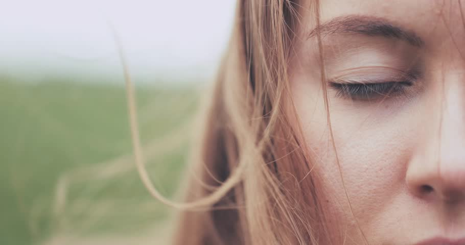 Close Up of Woman Eyes Covered with Hair Blowing on the Wind. SLOW MOTION 4K DCi. Green Eyes. Determined Female Sight. Stormy weather, autumn, winter, spring. | Shutterstock HD Video #30491584