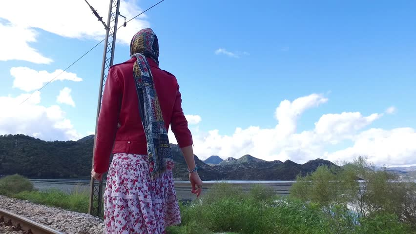 Walking girl on the railway under the blue sky. Footage. Walking girl on the railway under the blue sky. Happy asian woman travel taking photo at railway station, Concept of holiday and travel