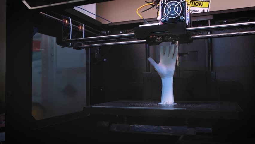 3D printer at work, 3D printer print the human hand, 3D printer print the whiter human hand, Hand Shape Product Printed With 3d Printer | Shutterstock HD Video #30499348